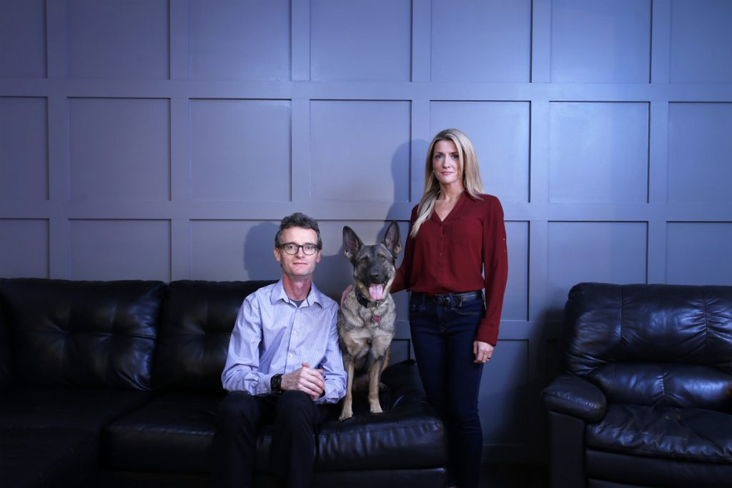Hagen Blaszyk and Linda Murray pose for a portrait with Luna, a German Shepherd, in Murray's home. Blaszyk and Murray cofounded an organization that pairs veterans with service animals to help treat their PTSD.