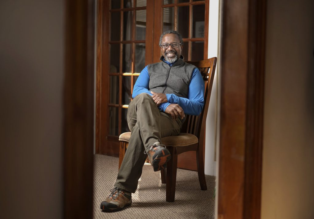 Therapist RJ Reid poses for a photo in the waiting room of his practice in South Portland on Monday, November 12, 2018. Reid started a group for people upset over the election of President Trump and they have transformed it into an informal agency that helps immigrants connect with services they need.