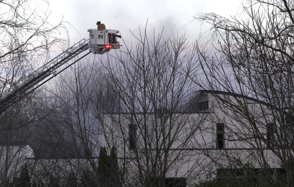 Firefighters work to extinguish a fatal fire in Colts Neck New Jersey on Tuesday. One of the owners is a technology CEO. A home owned by a relative who is vice president of the same company also burned Tuesday