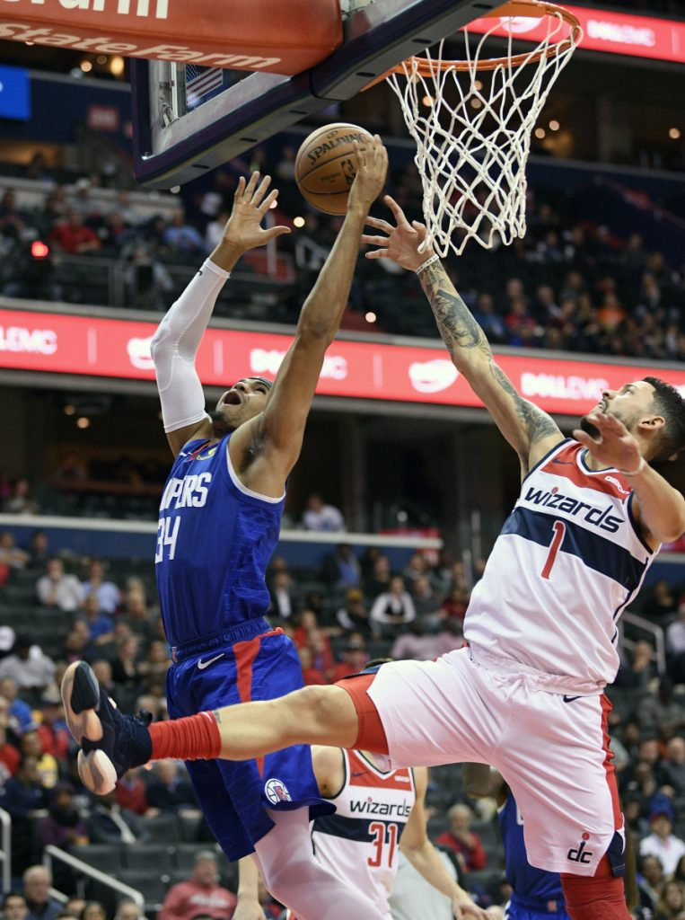 Clippers forward Tobias Harris, left, battles for the rebound with Austin Rivers of the Wizards during Tuesday's game in Washington.