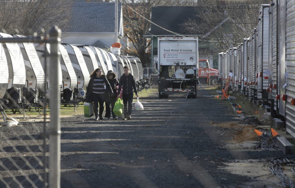 Sonia Geha, left, and her mother, Laila Eid, center, both of Lawrence, Mass., depart on Nov. 14 from a trailer camp for people affected by the natural gas line blasts that destroyed or damaged more than 200 homes.