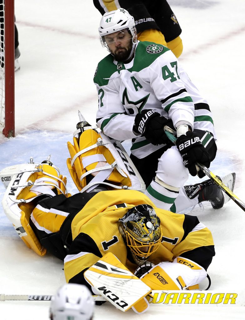Penguins goalie Casey DeSmith covers a rebound before Alexander Radulov of the Stars can reach it in Wednesday night's game at Pittsburgh. The Penguins cruised to a 5-1 win.