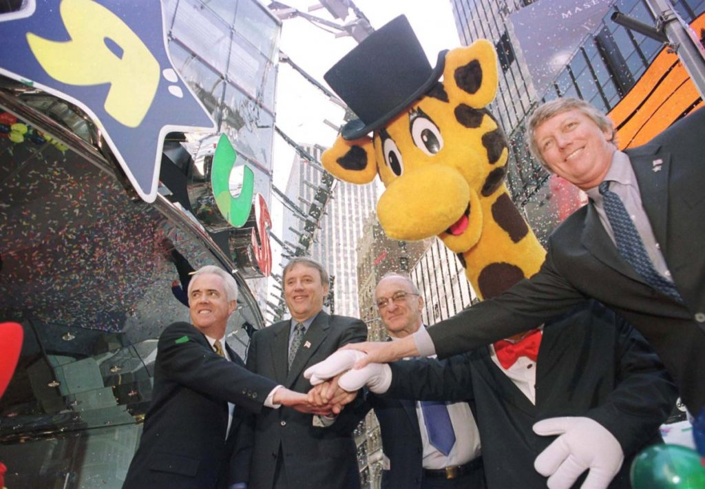 Officials mark the opening of a Toys R Us in New York's Times Square in 2001. The company that revealed in March that it would be closing and cutting loose 33,000 workers is back from the grave through a subsidiary.
