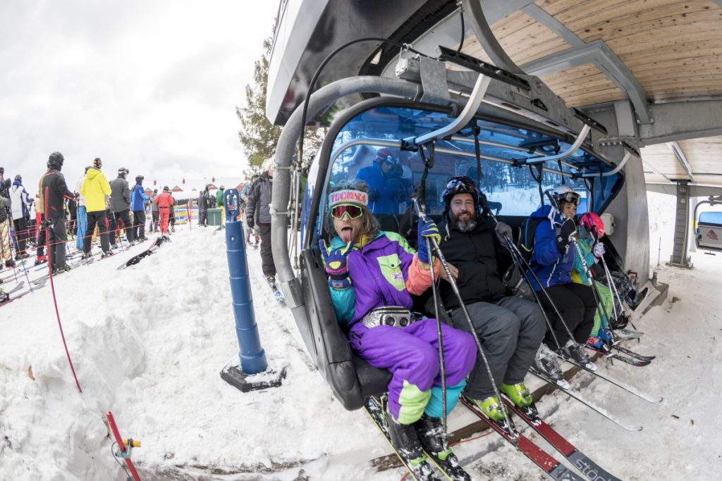 Skiers prepare to ride a chair lift at the Mount Snow ski resort in West Dover, Vt., this month. Early-season snow and cold temperatures are helping New England ski resorts start off the season strong.