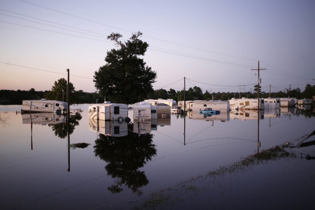 Vehicles and trailers are submerged Sept. 6 at a trailer park flooded by Hurricane Harvey in Rose City, Texas. Many storm-damaged structures are rebuilt stronger to withstand big storms.
