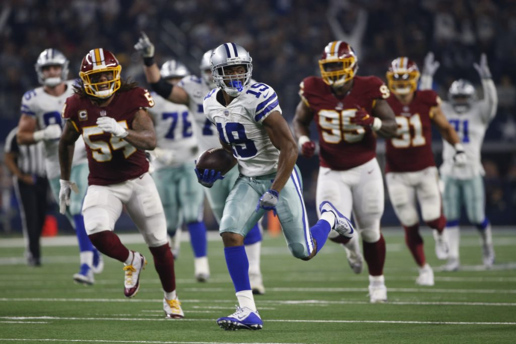 Dallas wide receiver Amari Cooper pulls away on a touchdown reception against Washington on Thursday.