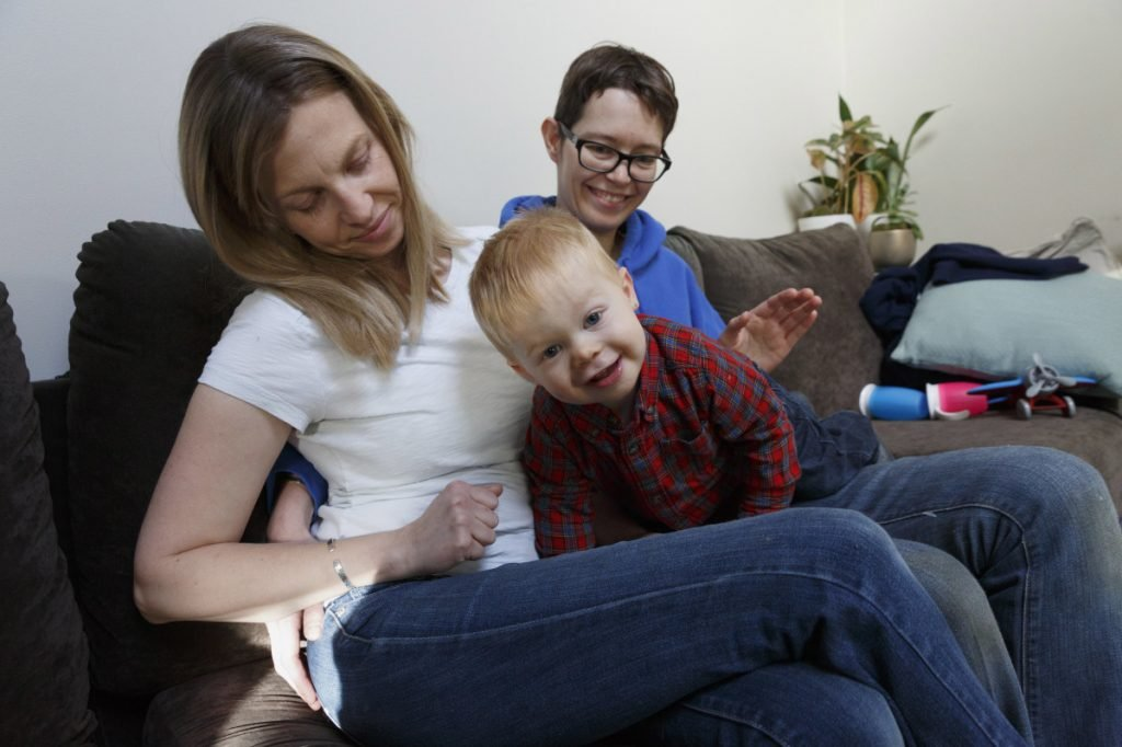 Anna Borman, left, and her partner, Sara Watson, play with their son, Eli, at home in Narragansett, R.I. Three years after the landmark U.S. Supreme Court case that gave same-sex couples the right to marry nationwide, a patchwork of outdated state laws governs who can be a legal parent.