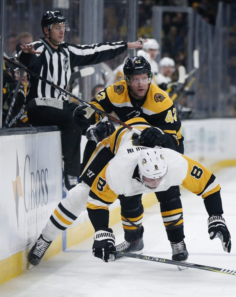 Boston's David Backes checks Pittsburgh's Brian Dumoulin during the second period of the Bruins' 2-1 win in overtime on Friday in Boston.