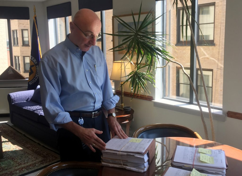 Mark Robbins, the last remaining member of the Merit Systems Protection Board, looks through stacks of legal cases piled up on his desk in Washington office. Robbins reads through federal workplace disputes, analyzes the cases, marks them with notes and logs his legal opinions. He then passes them along to nobody. He's the only member of a three-member board that legally can't operate until the president and Congress give him at least one colleague.