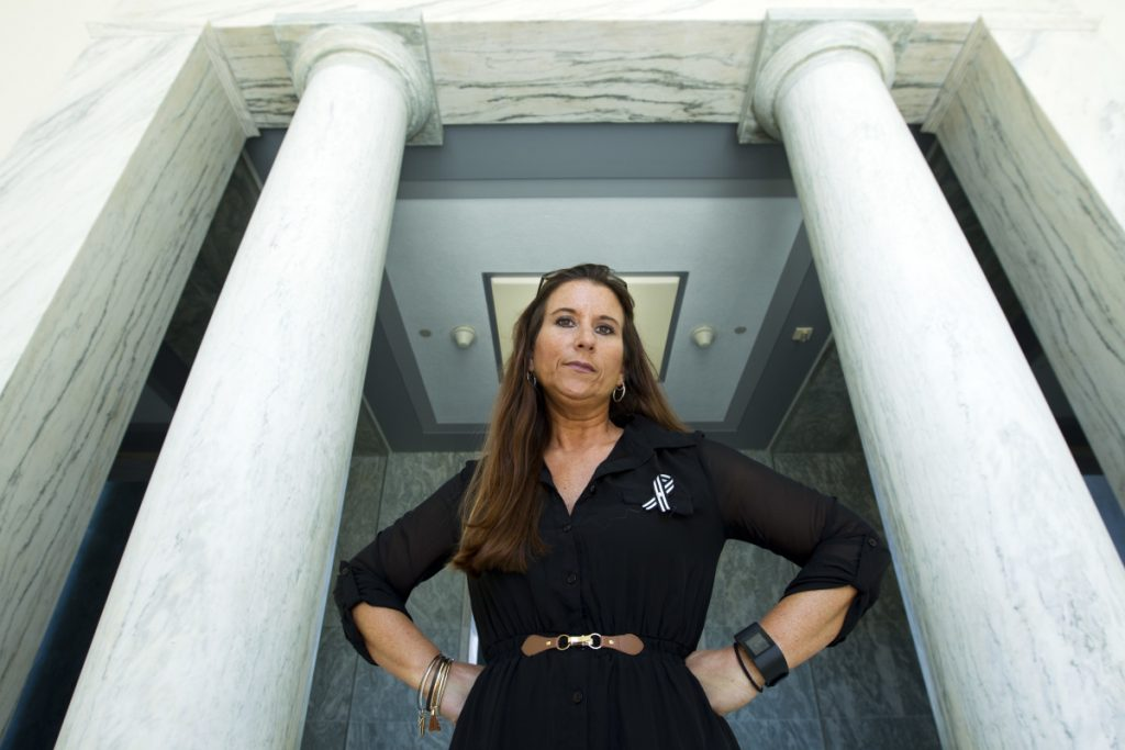 Jamee Cook, shown in September, blames her breast implants for causing her medical problems that stopped once she had the implants removed. She now lobbies the FDA and congressional leaders to do a better job of tracking and regulating medical devices.
