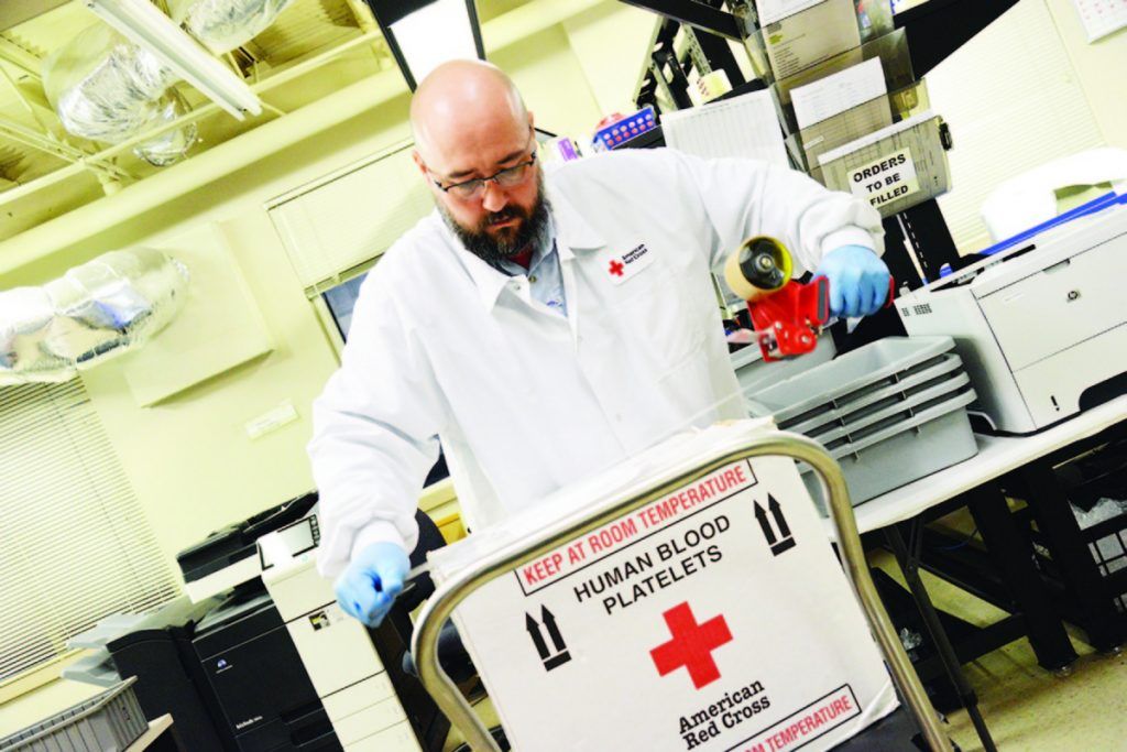 Red Cross employee Bob Otwell prepares blood products for distribution to nearby hospitals in 2017 in Houston, Texas.
