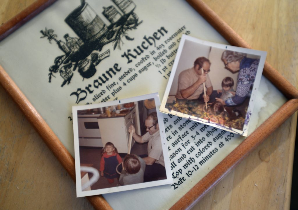 """A German ancestor brought the recipe for Braune Kuchen (""""brown cake"""") – framed above beside some old family photographs – to the United States in the early 20th century."""