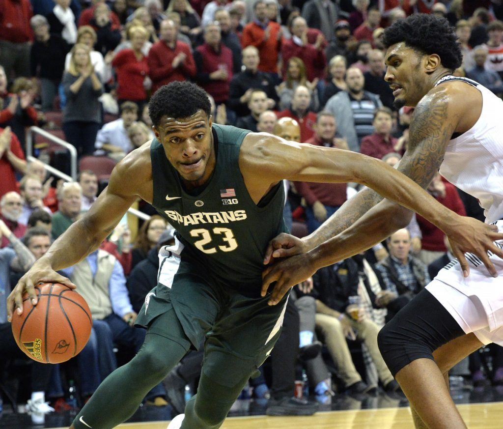 Michigan State forward Xavier Tillman attempts to drive past the defense of Louisville center Malik Williams during the Cardinals' 82-78 win at home Tuesday.