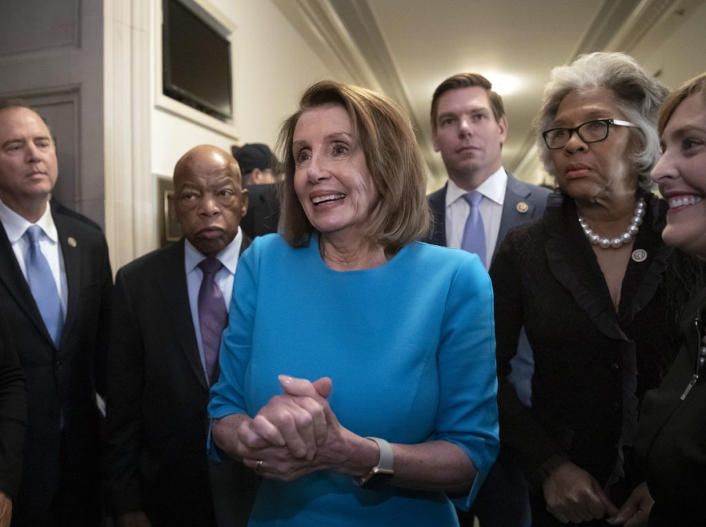 House Democratic Leader Nancy Pelosi of California, joined at left by Rep. John Lewis, D-Ga., and Rep. Eric Swalwell, D-Calif., right, emerges victorious from the Democratic Caucus leadership elections, as her party takes the majority in the new Congress in January, at the Capitol in Washington, Wednesday, Nov. 28, 2018. Associated Press/J. Scott Applewhite