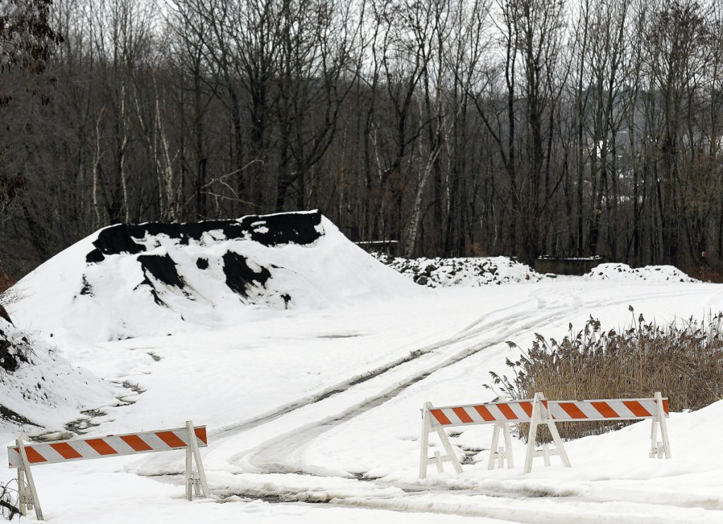 Barricades blocking the access road to a residence behind the Augusta Public Works site on North Street, shown Wednesday, have been moved aside.