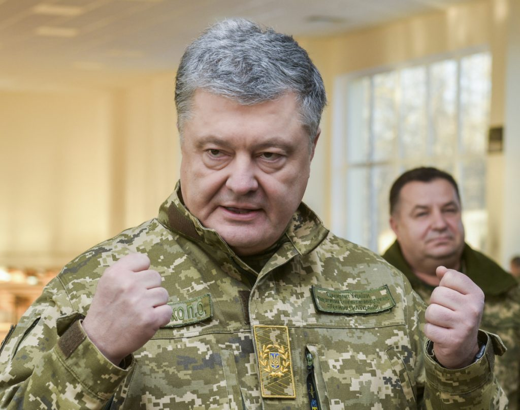 Ukrainian President Petro Poroshenko has ordered martial law over an incident for which he and Vladimir Putin trade blame.
