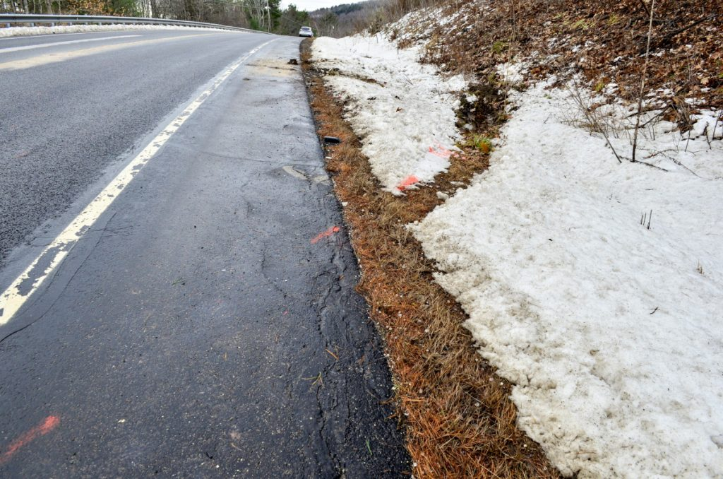 Orange paint marks an accident scene Thursday on Route 3 east of Lake St. George State Park in Liberty. Three people died on the road in two days.