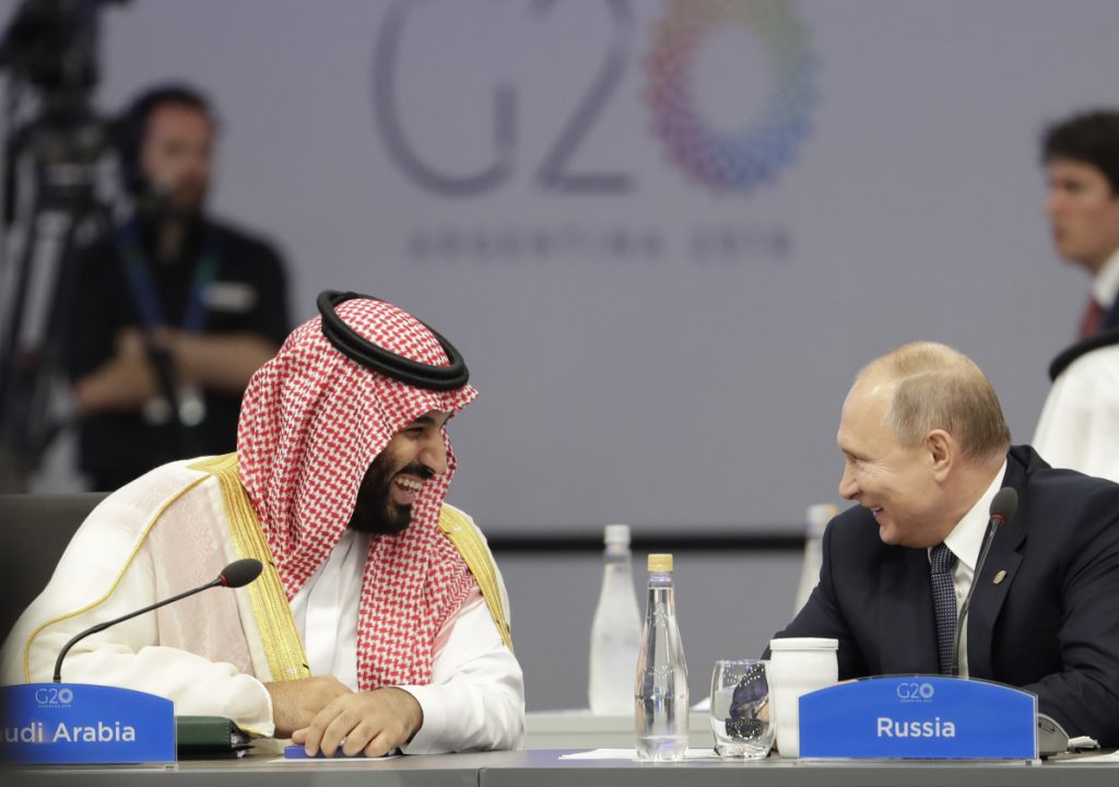 Saudi Arabia's Crown Prince Mohammed bin Salman and Russia's President Vladimir Putin speak at the start of the G-20 summit in Buenos Aires.