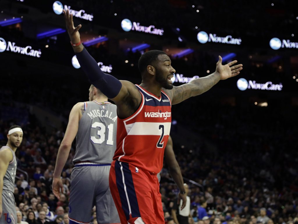 John Wall of the Washington Wizards reacts Friday night after being called for a foul during a 123-98 loss to the Philadelphia 76ers.