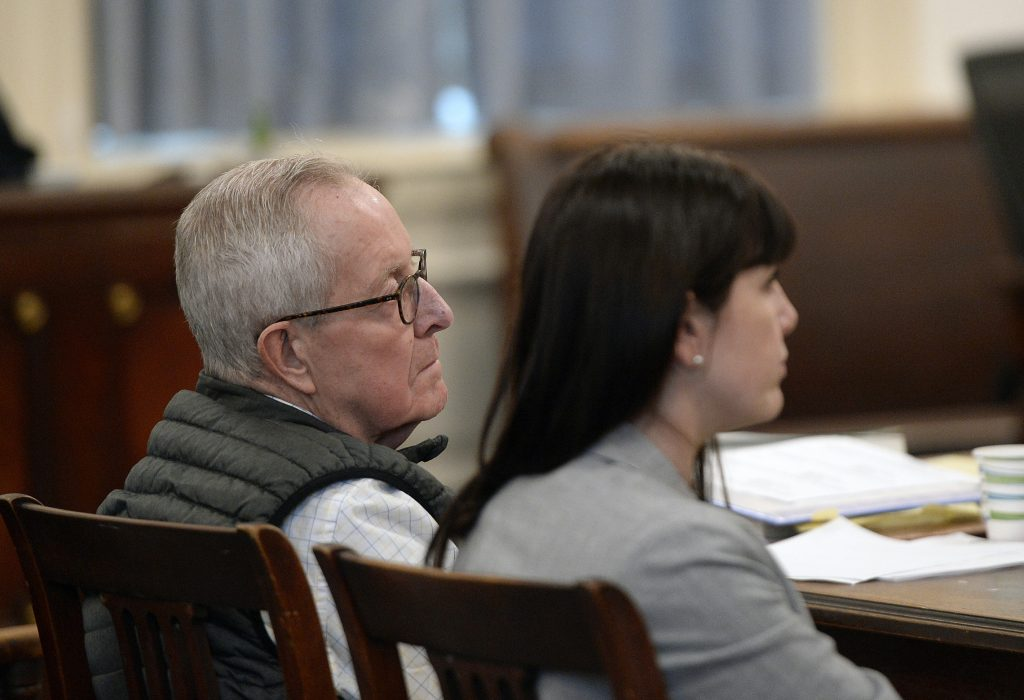 Ronald Paquin listens to his attorney Roger Champagne give his closing argument Wednesday in York County Superior Court. Sitting to his right is Paquin's attorney Valerie Randall. Paquin is charged with sexually abusing two boys on trips to Maine in the 1980s.