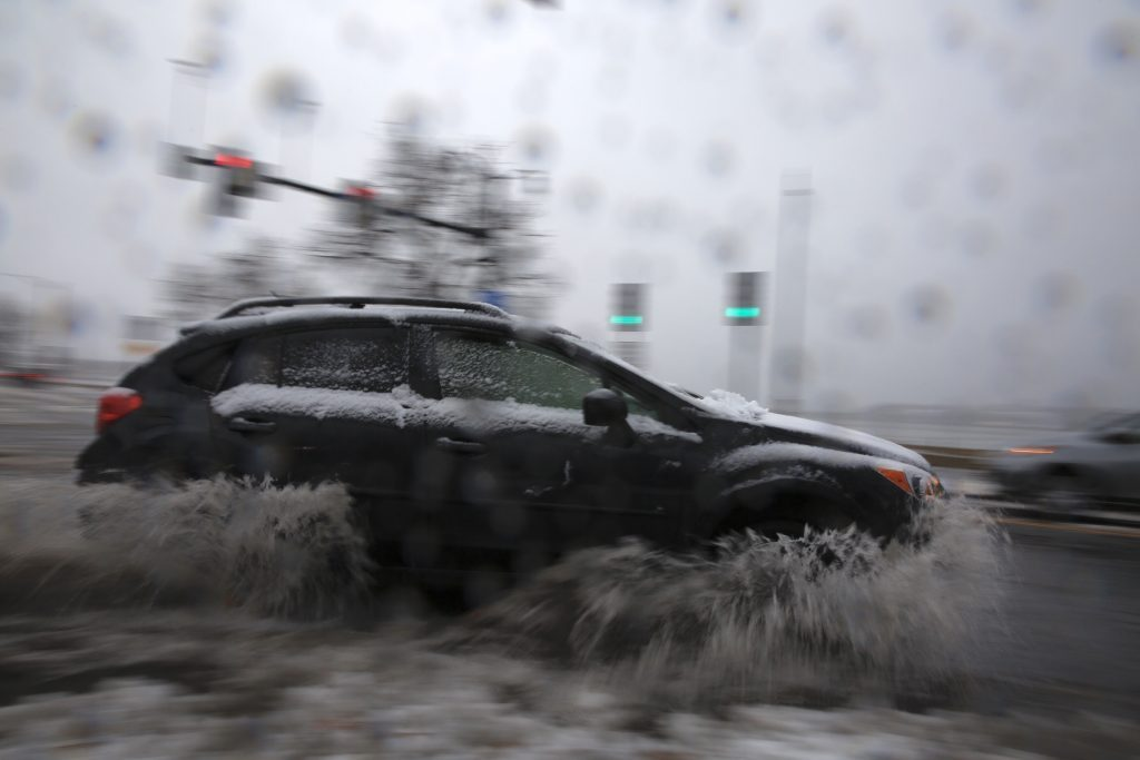 Rain and snow arrive causing treacherous travel conditions