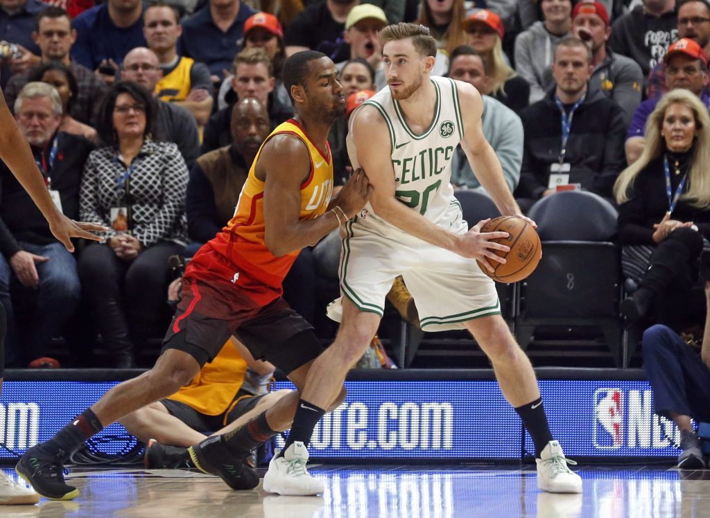 Utah Jazz guard Alec Burks, left, guards Boston Celtics forward Gordon Hayward, right, in the first half Friday night in Salt Lake City, Utah.