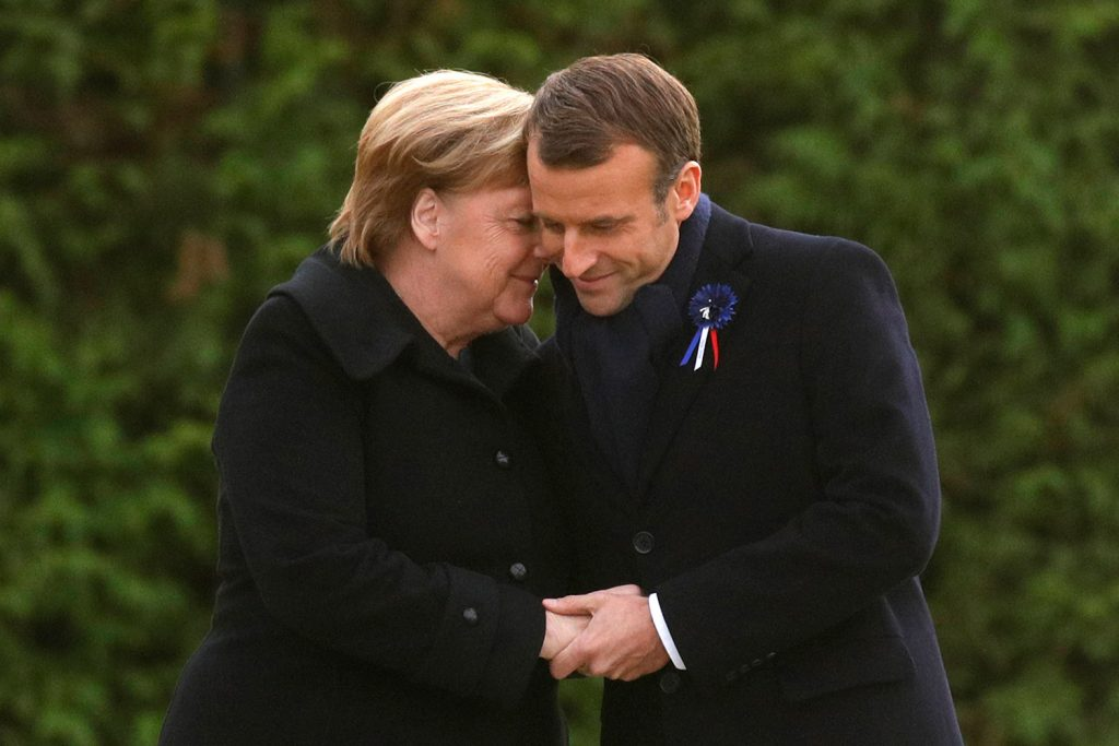 French President Emmanuel Macron and German Chancellor Angela Merkel are head to head after unveiling a plaque in the Clairiere of Rethondes during a commemoration ceremony for Armistice Day, 100 years after the end of World War I, in Compiegne, north of Paris, France, on Saturday.