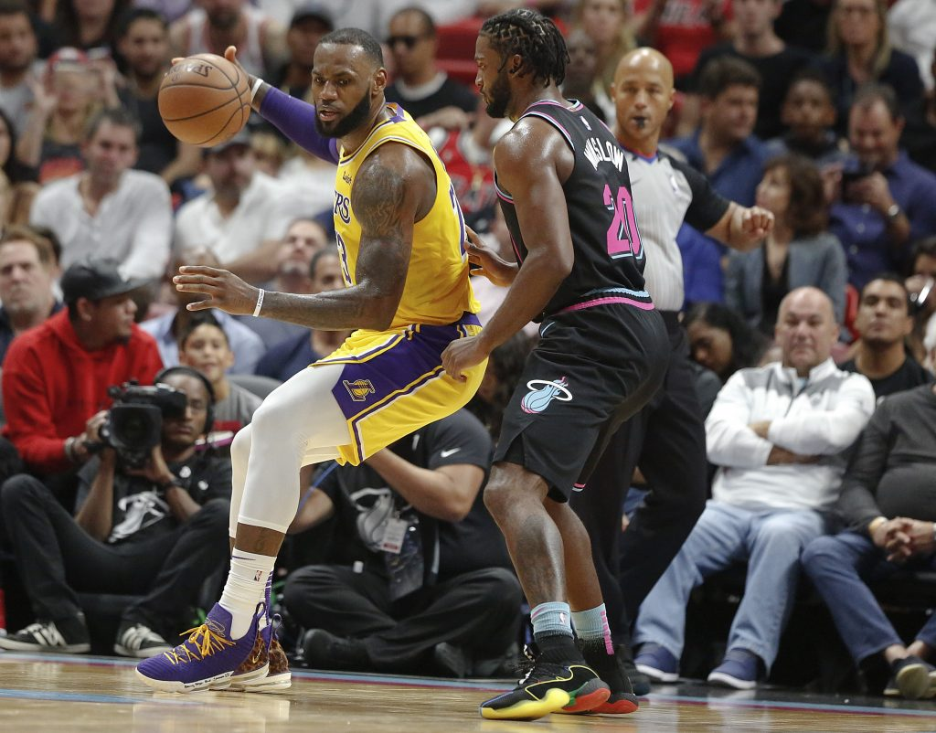 8f829f8e5 Los Angeles Lakers forward LeBron James keeps the ball away from Miami Heat  center Hassan Whiteside