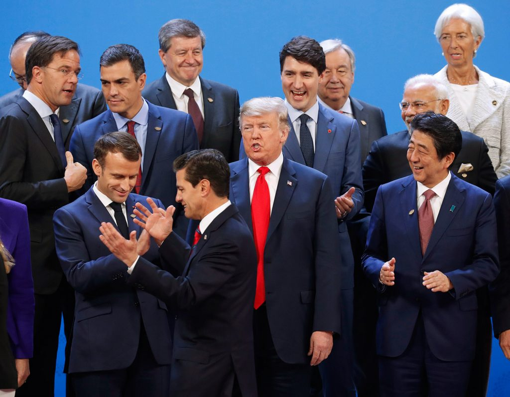 President Trump and other heads of state react to Mexico's President Enrique Pena Neto, throwing his hands up, being the last one to arrive for the group photo at the G20 summit, Friday in Buenos Aires, Argentina.