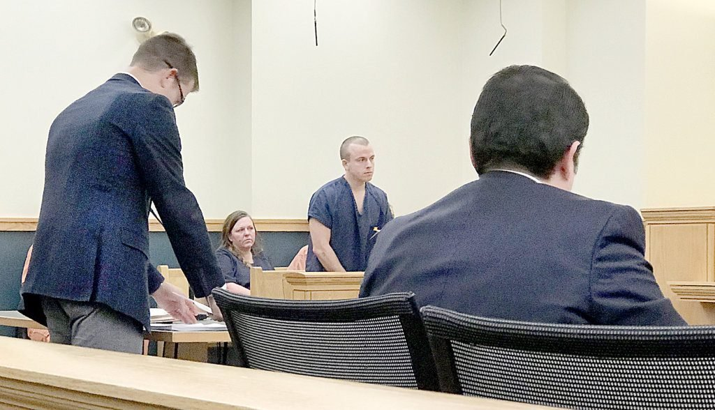 Anthony Waack, center, is in 8th District Court in Lewiston Monday on charges related to a stolen vehicle and other items. At left is defense attorney Jason Ranger and, at right, Assistant District Attorney Nathan Walsh.