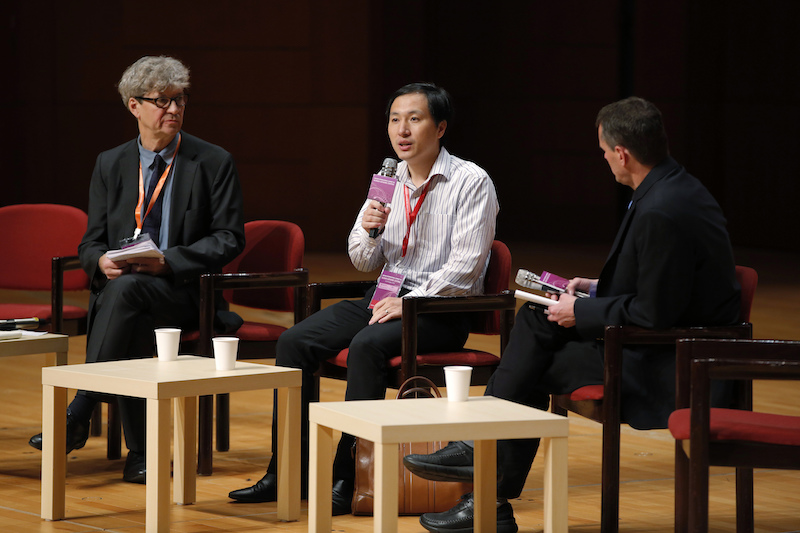 He Jiankui, a Chinese researcher, center, speaks during the Human Genome Editing Conference in Hong Kong on Wednesday.