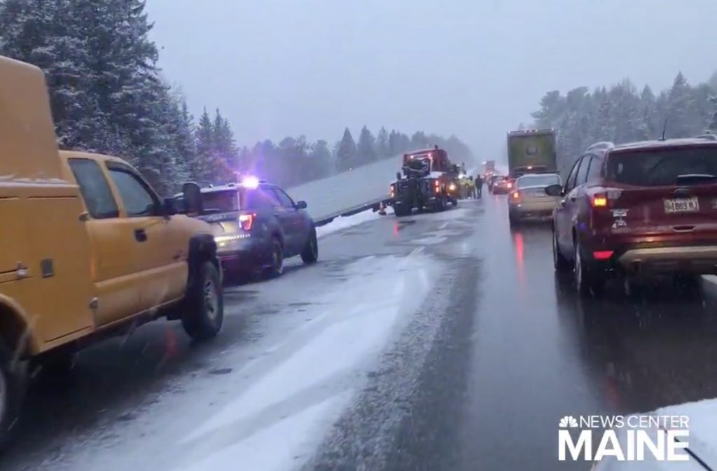 The truck that jackknifed on Interstate 95 Tuesday afternoon lies on its side. Drivers who tried to avoid the wreck when it happened began to slide on the slick pavement, with most ending up off the road.