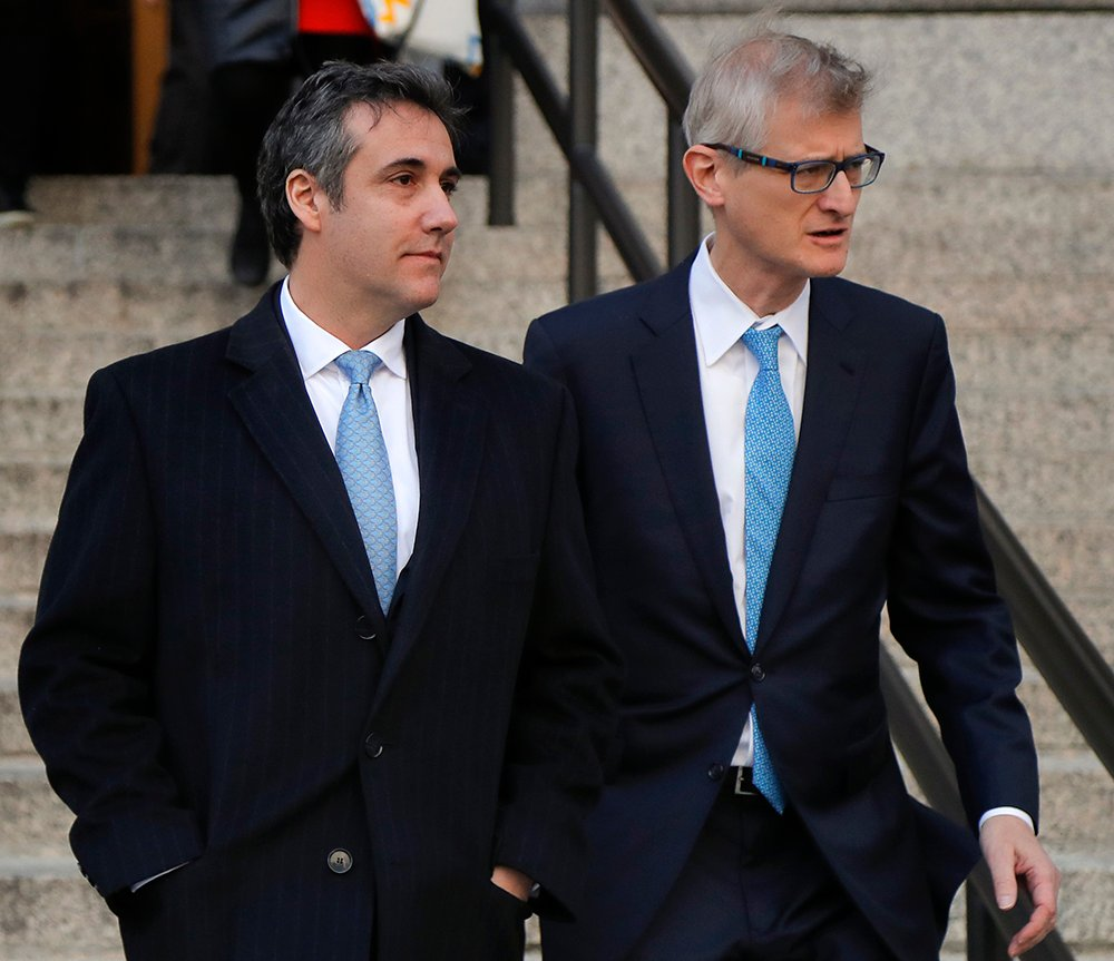 Michael Cohen, left, walks out of federal court with his attorney Guy Petrillo on Thursday morning in New York.