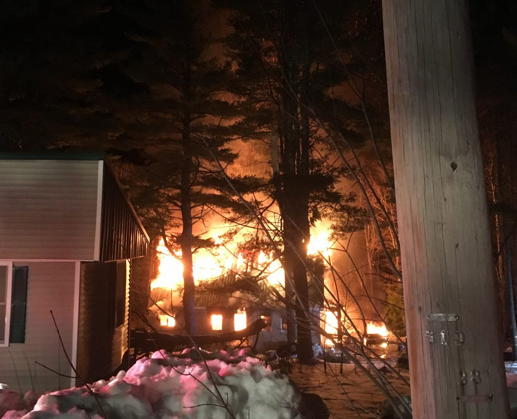 Fire consumes a house on Ben Gilpatrick Road in Hiram early Saturday. A 19-year-old man died in the fire.