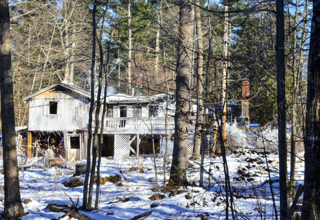 This photo taken at 10:43 a.m. on Saturday shows 358 Narrows Pond Road in Winthrop after it was heavily damaged by an overnight fire.