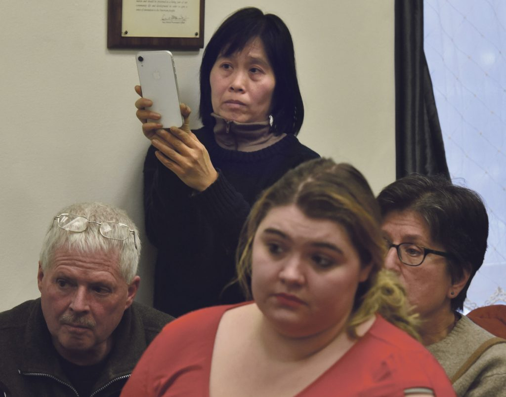 Sally Kwan records Somerset County Commissioners regarding CMP's New England Clean Energy Connect project during a meeting in Skowhegan on Wednesday. Kwan opposes the project.