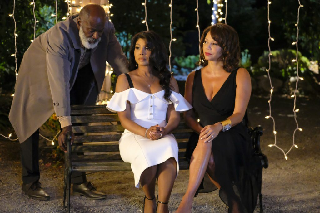 "This image released by Lifetime shows Toni Braxton, center, and Gloria Reuben, right, in a scene from ""Every Day is Christmas."""