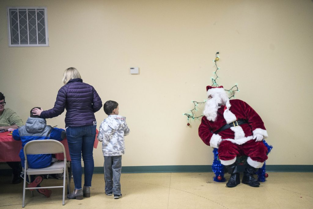 Santa Claus greets children Saturday at the Humane Society Waterville Area shelter in Waterville. The organization held an open house that day to raise money to keep the shelter open.