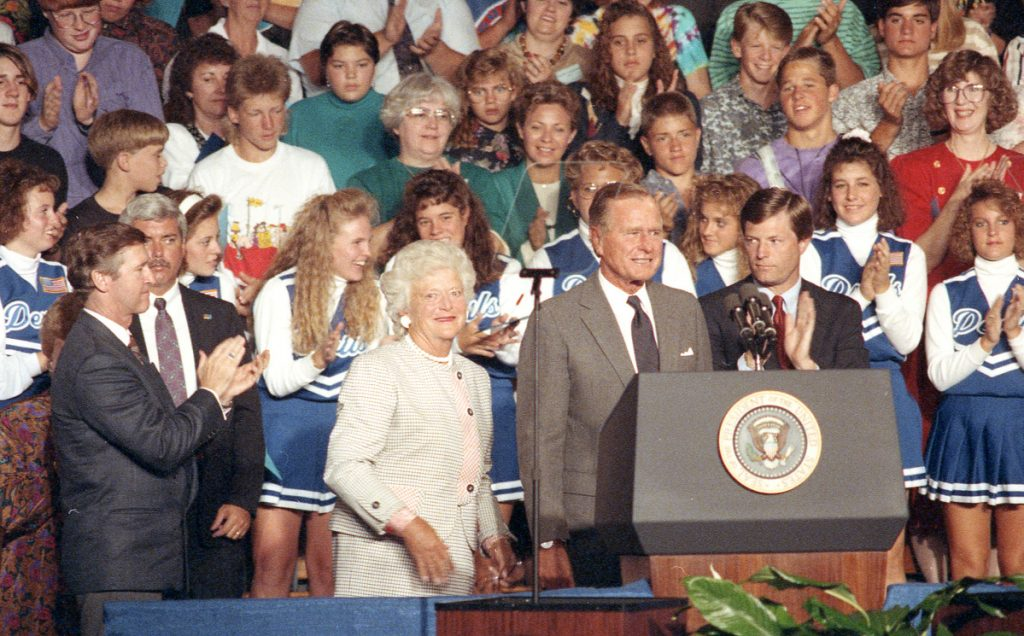 President George H.W. Bush and the first lady receive a round of applause during his visit to Lewiston High School in 1991.