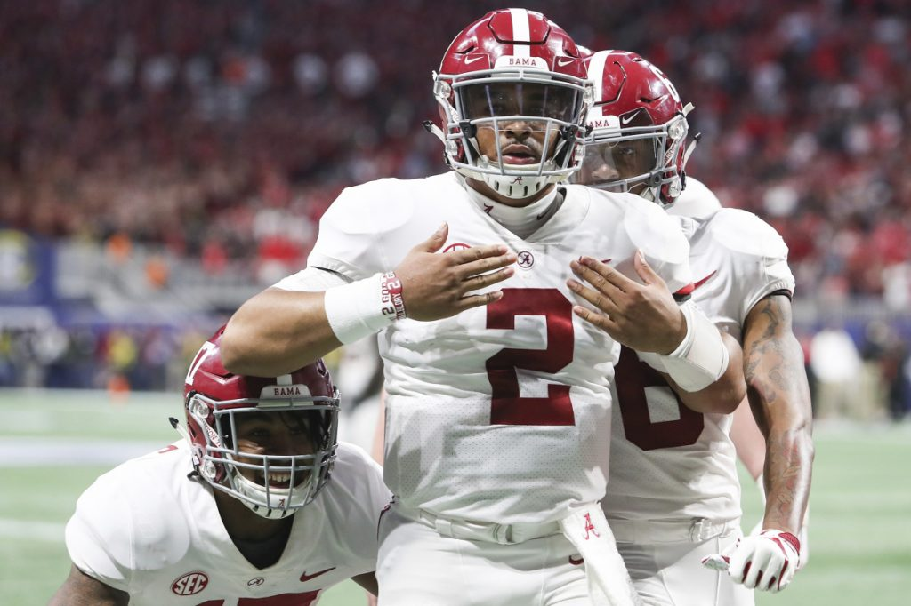 Alabama quarterback Jalen Hurts (2) celebrates after scoring the during the fourth quarter against Georgia during the SEC Championship Game on Saturday in Atlanta.