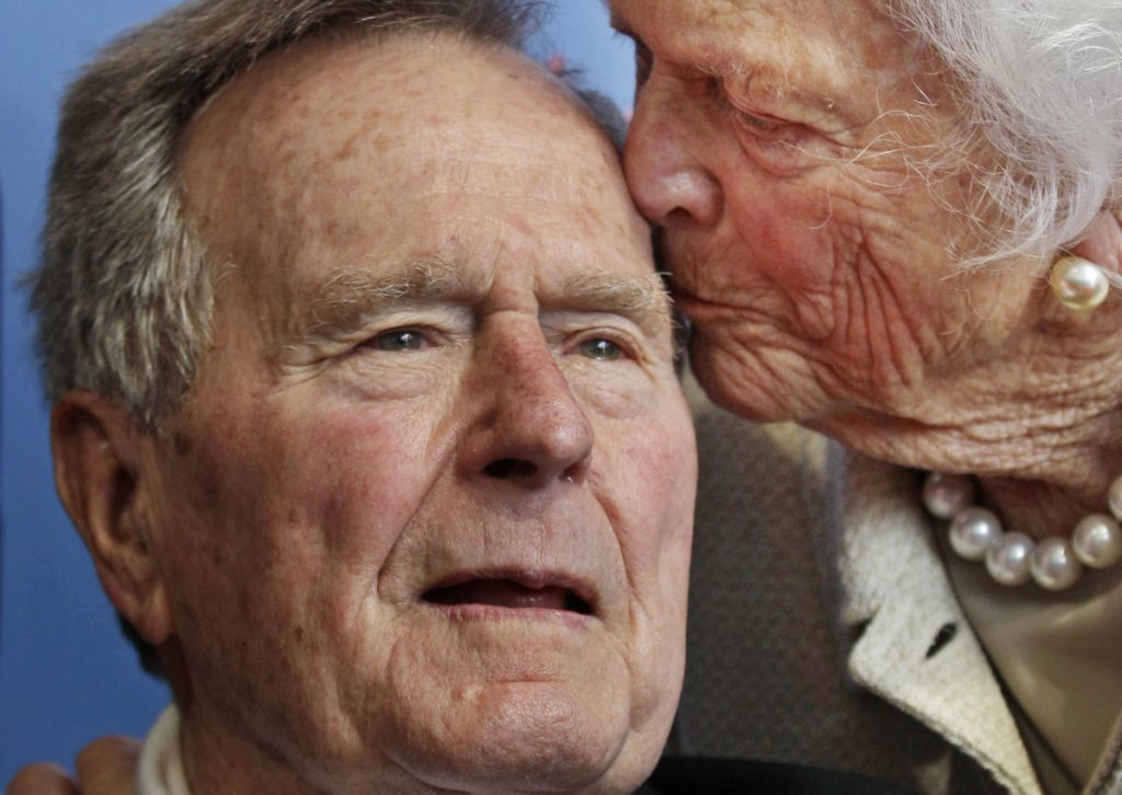 George and Barbara Bush, shown in 2012, will be missed in Kennebunkport, a neighbor writes.