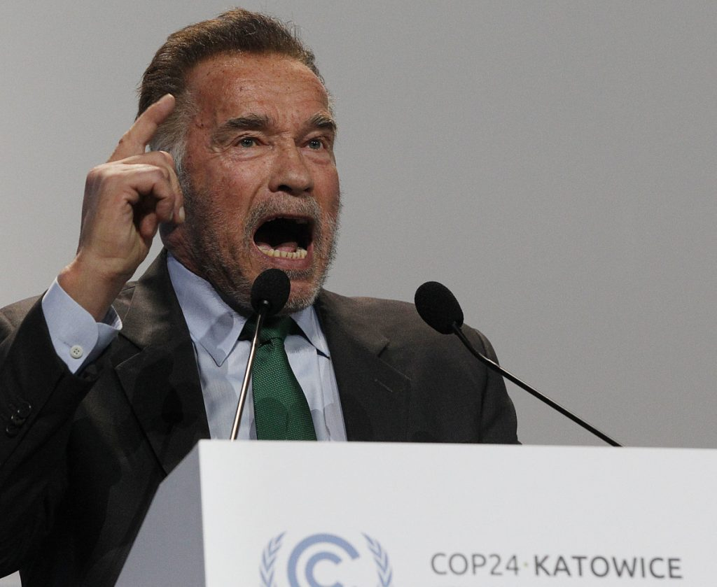 Actor and former California governor Arnold Schwarzenegger delivers a speech at the start of the U.N. climate conference in Poland.