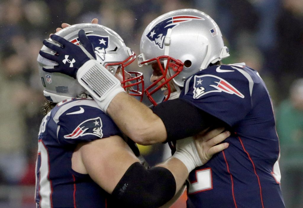 James Develin with center David Andrews, left, during the second half of an NFL football game against the Minnesota Vikings, Sunday, Dec. 2, 2018, in Foxborough, Mass. (AP Photo/Elise Amendola)