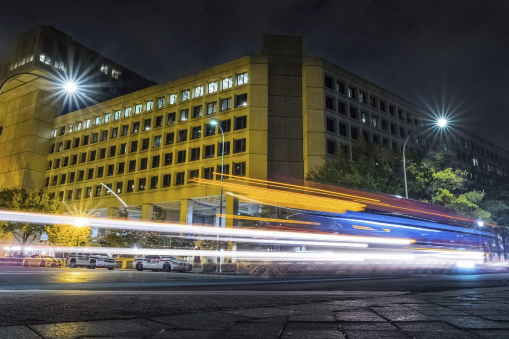 "Traffic along Pennsylvania Avenue in Washington streaks past the Federal Bureau of Investigation headquarters building. The National Republican Congressional Committee said Tuesday that it was hit with a ""cyber intrusion"" during the 2018 midterm campaigns and has reported the breach to the FBI."