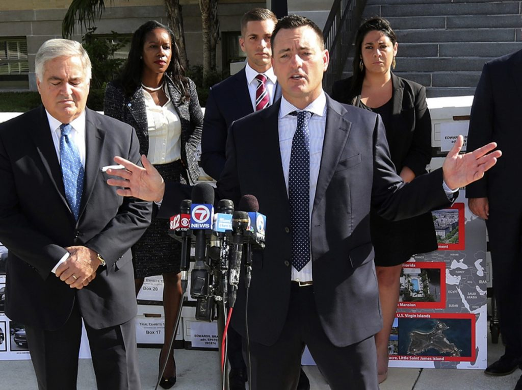 Attorney Brad Edwards holds a press conference following Jeffrey Epstein's settlement on Tuesday in Palm Beach. Labor Secretary Alexander Acosta, left, was the attorney who approved Epstein's secret deal in 2008 and helped him avoid a lifetime jail sentence.