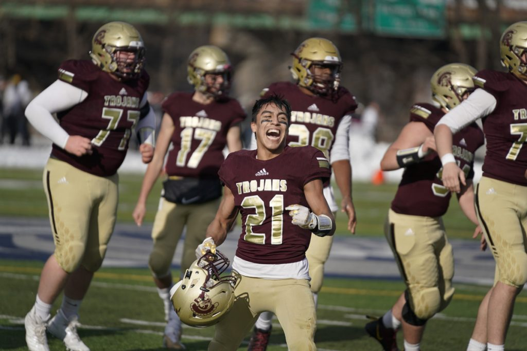 Anthony Bracamonte of Thornton Academy celebrates after the Trojans' victory over Portland in the Class A football state championship at Portland's Fitzpatrick Stadium on Nov. 17. (Staff photo by Gregory Rec/Staff Photographer)