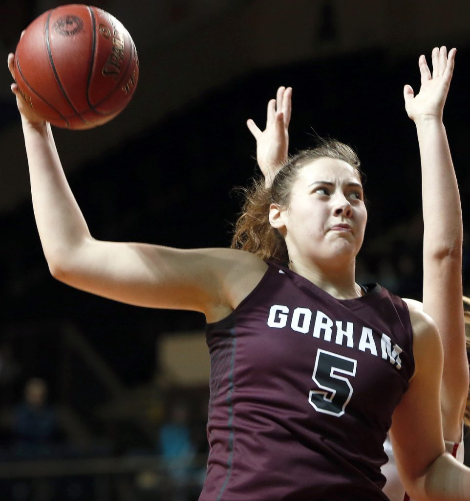PORTLAND, ME - FEBRUARY 20: Gorham's Mackenzie Holmes comes away with a rebound during a semifinal game against South Portland on Tuesday at Cross Insurance Arena. (Staff photo by Ben McCanna/Staff Photographer)