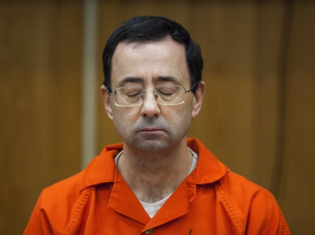 Former USA Gymnastics doctor Larry Nassar listens during his sentencing in Charlotte, Mich., last February. Over 350 athletes have accused Nassar of molesting them.