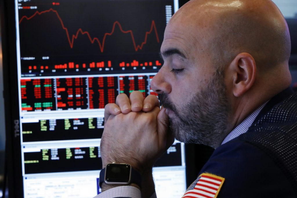 Trader Fred DeMarco works on the floor of the New York Stock Exchange on Thursday. U.S. stocks tumbled in early trading following a sell-off in overseas markets.