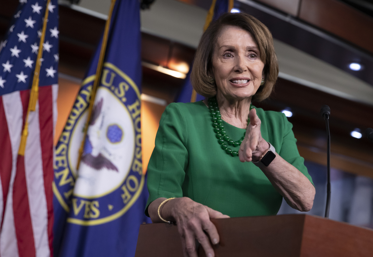 House Democratic Leader Nancy Pelosi speaks with the media on Thursday in Washington. Pelosi says building a border wall would be immoral.